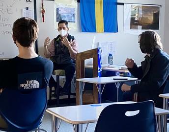 Social Studies teacher Jason Anderson speaks to his class.