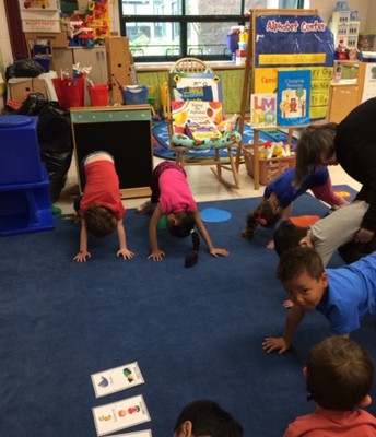 Enjoying yoga in Preschool!
