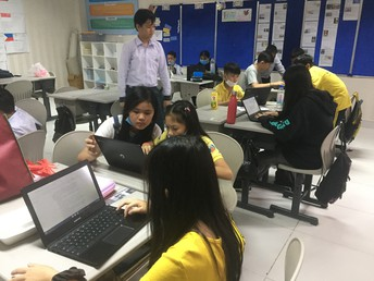 Grade 6 students researching about global brands