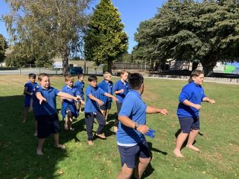 Caleb and Rashaun teach some of the boys.