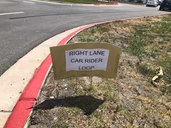 Car Rider line - please stay in the right lane until the line splits at the sign.