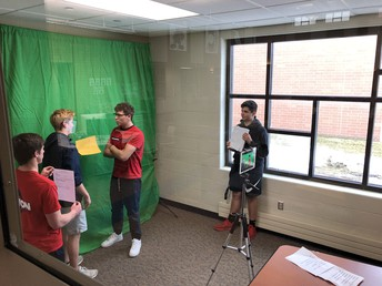 Students in Mrs. Strong's Spanish 4 class create videos with green screen