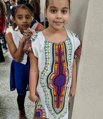 Lexi Gaskin wears African attire.