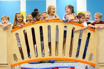 Preschool students laughing and smiling on bridge at Shaner Early Learning