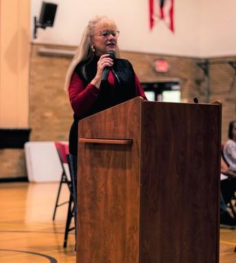 Ms. Garrett presenting at 2019 Veterans Day Assembly [photo credit:  Jake Leonard Photography]