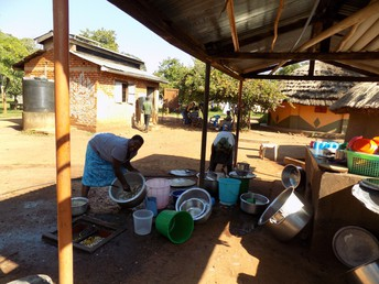 Doing dishes at Bweyale Village