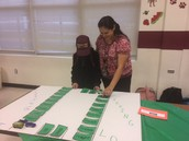 Adriana Mayces helped a student with sight words