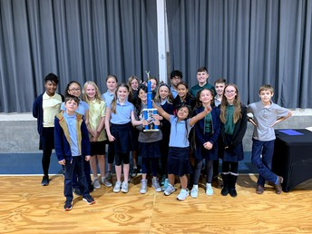 6th grade earns the School Spirit trophy by showing 100% participation for Red Ribbon Week