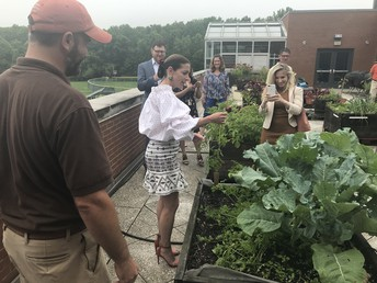 The First Lady enjoyed picking carrots from our roof top planters.