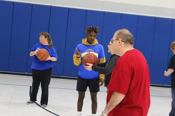 Boys Basketball Volunteers With Special Olympics