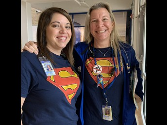image of faculty in super hero shirts