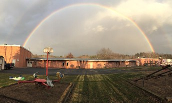 Double rainbow over Fulks Run Elementary viewed from back of school.