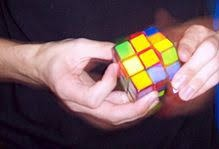 two hands turning a Rubik's cube