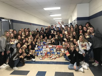 Cheer donates to Center of Hope Thanksgiving