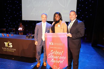 Westlawn Middle School principal Dr. Tiffany Davis accepts the School Showcase Award.