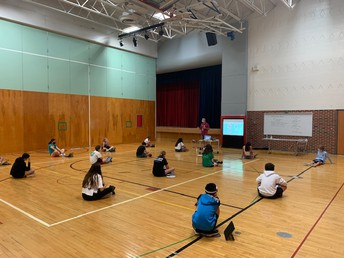 Mr. Henley walking through the ground rules in PE