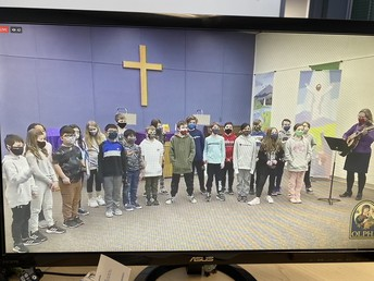 4P singing at the school division Ash Wednesday mass.
