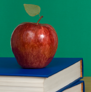 Picture of apple on books