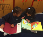 Buddy reading in PreK...Exposure to text and pictures is so important!