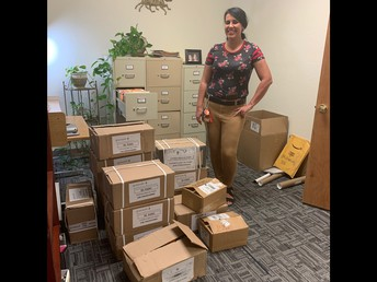 Asha Baker Hernandez with donated books for English Learners from the Consulate of Mexico