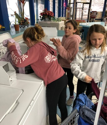 Students Washing Coats for the Cozy Collection