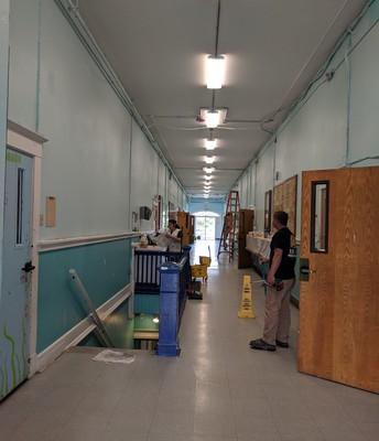 The Hallway with New Lighting...and Sheetrock!