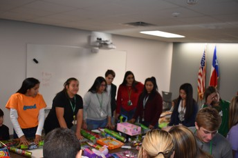 Students wrap donated gifts