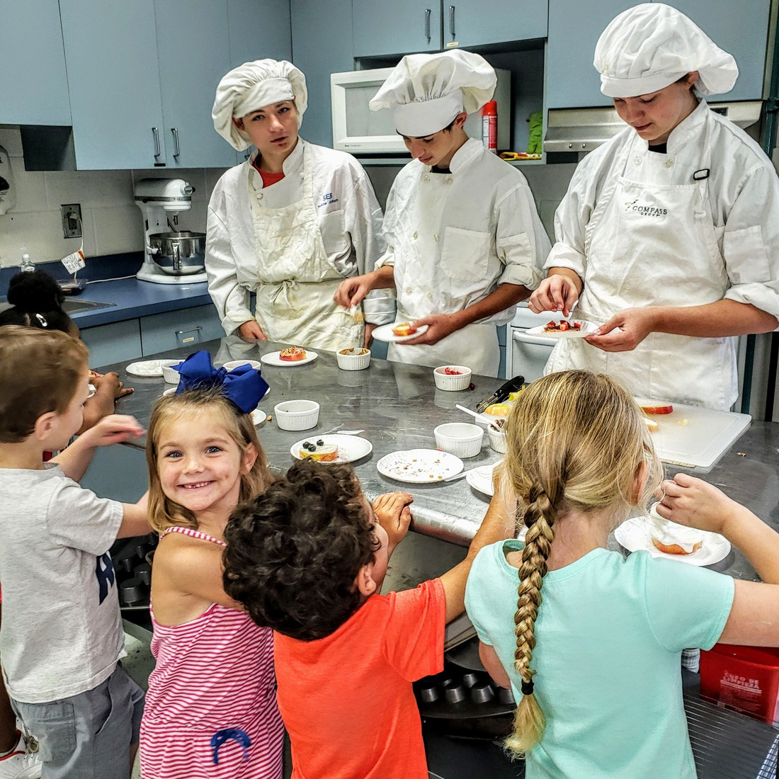 culinary arts students cook for pre-k students