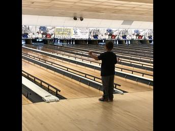 Mason coaches his bowling ball to the pins!