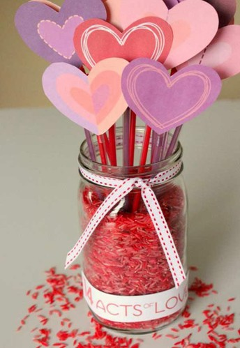 Jar of heart shaped decorations.