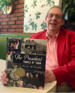 "Photograph of Author Bob Withers with book ""The President Travels by Train, Politics and Pullmans"""