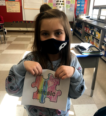 Student holding coloring project