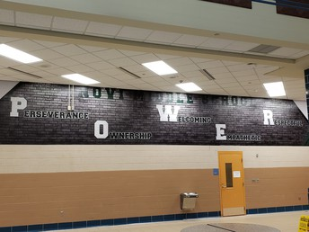 Picture of the new mural in the cafeteria of Power, Ownership, Welcoming, Empathetic and Respectful