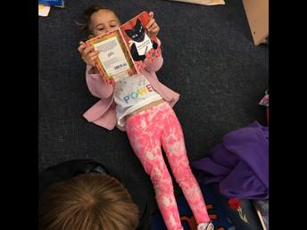 Enjoying a good book in Kindergarten.
