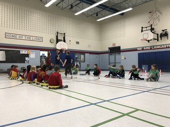 Primary Students lining up for scooter basketball at recess led by our Athletic Ministry and supervised by school staff