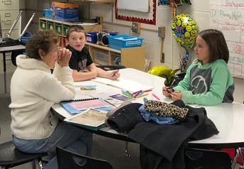 Volunteer, Rita, Talks with Fourth Graders