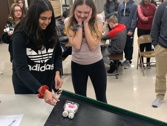 Testing designed, assembled 'cars' for speed in 8th grade Science