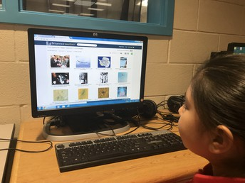 Students researching NASA website.