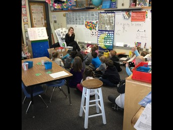 Learning about dental health from a dental assistant.