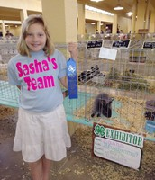 Sasha Vest and her rabbit take 1st Place at State Fair