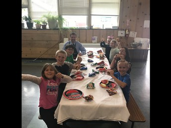 CES students enjoying the PBIS BBQ - Ultimate Burgers (burger, pulled pork, pineapple)