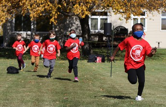 picture of kids in red shirts running