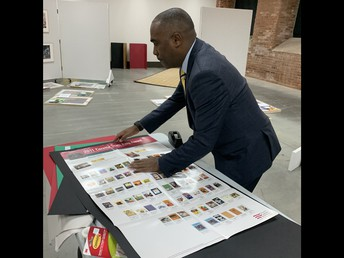 James Garvin working on a Coretta Scott King Book Awards Poster for The National Center for Children's Illustrated Literature  Exhibition