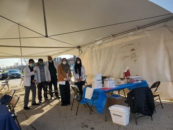 Volunteer health care providers offer at the FREE FLU SHOT under the Aqsa School tent