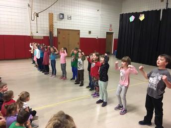 1st Grade singing their song at PBIS