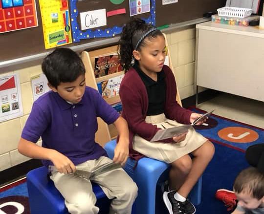 Students at Morgan reading to the PreK class.