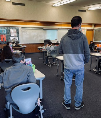In-person instruction is valuable.  Teachers walk to give immediate feedback to students.