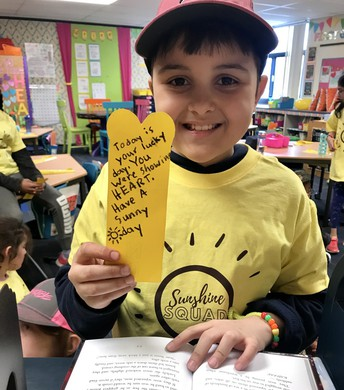 Student hiding kindness bookmarks