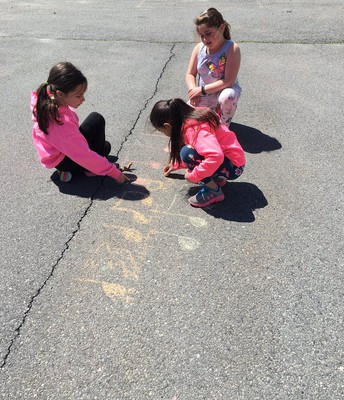 2nd graders enjoyed some sunshine while writing chalk rhythms while doing hand clapping games.
