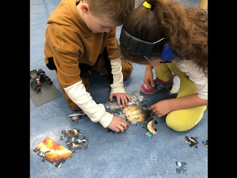 Space puzzle time in Kindergarten.